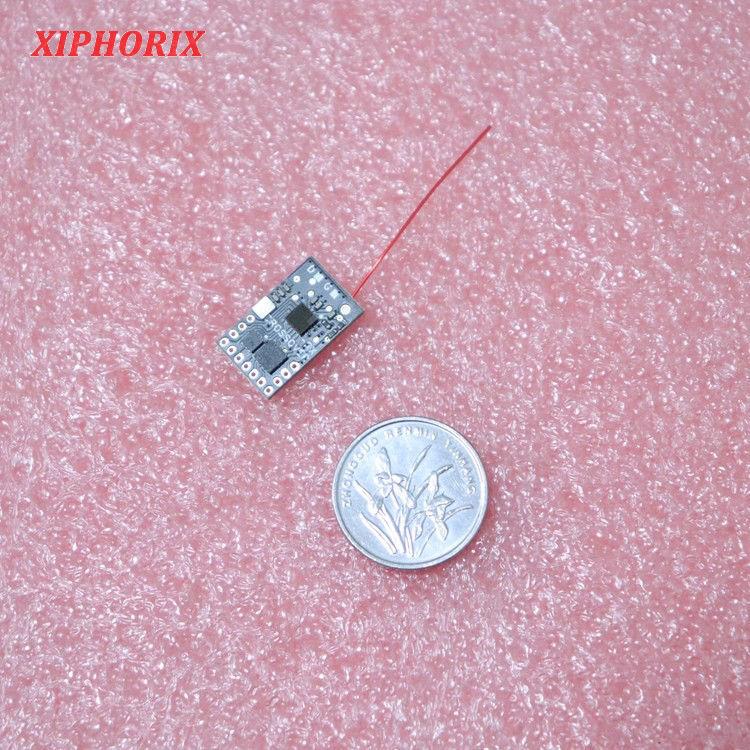 图片 2.4G微型5通道接收机 兼容多协议 部分带回传 内置5A单向有刷电调和两路电磁舵驱动 RX32M系列微型接收机